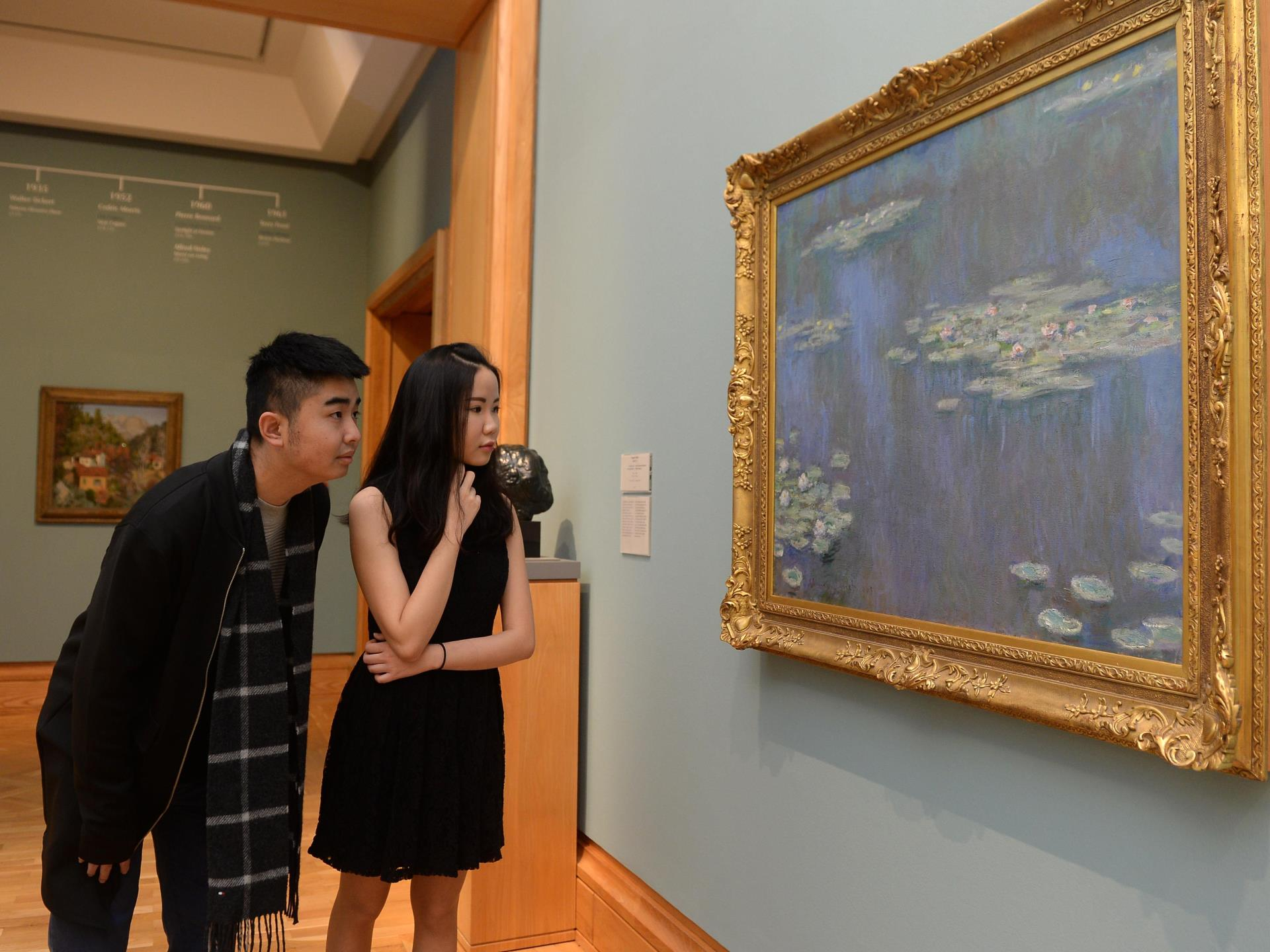 Visitors viewing Monet painting