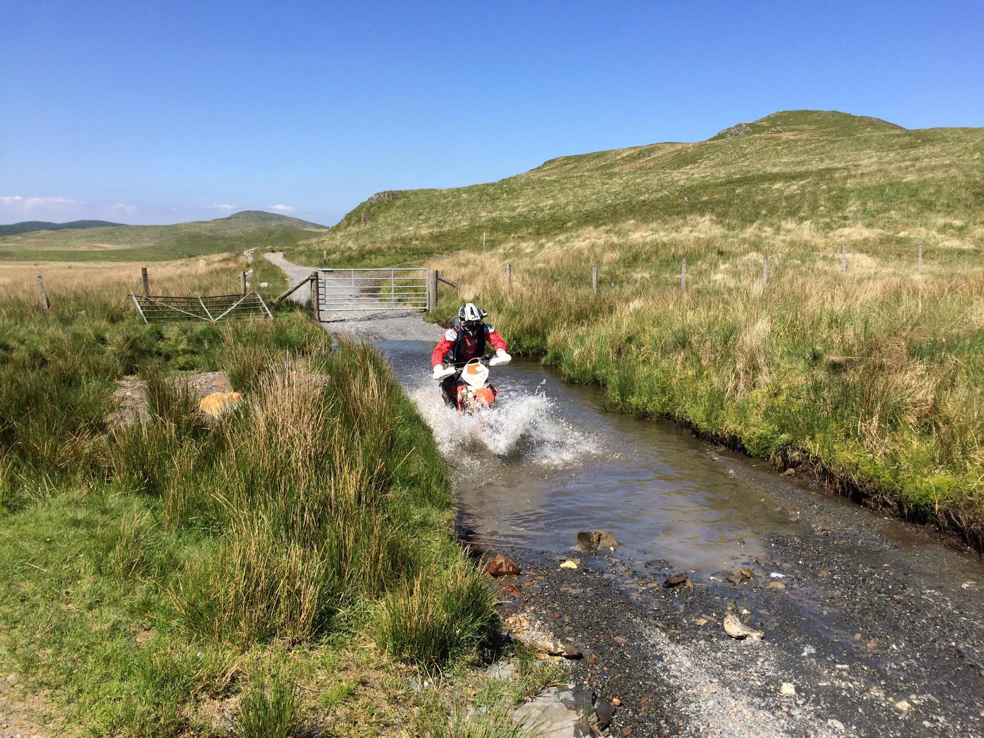 Motorcyclist fording a stream