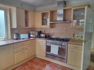 Kitchen with dishwasher and fridge freezer